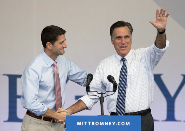 Republican presidential candidate former Massachusetts Gov. Mitt Romney, right, is greeted by running mate Rep. Paul Ryan, R-Wis., at the start of a rally, Tuesday, Oct. 23, 2012, in Henderson, Nev. F