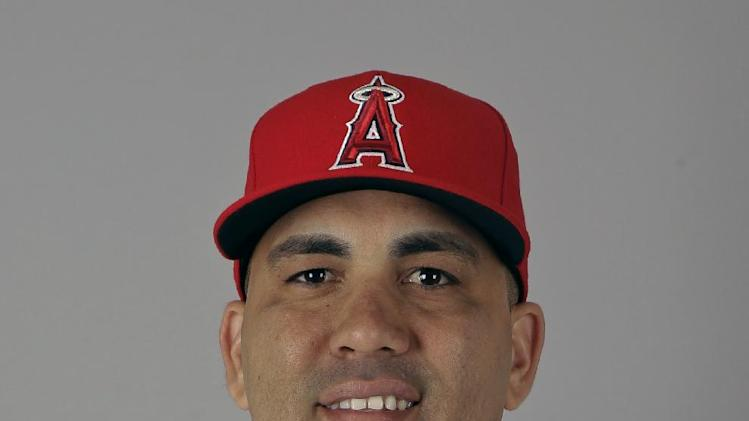 FILE - In this Feb. 29, 2012, file photo, Los Angeles Angels' Kendrys Morales poses in a baseball uniform in Tempe, Ariz. The Angels have traded power hitter Morales to the Seattle Mariners for left-hander Jason Vargas. (AP Photo/Morry Gash, File)