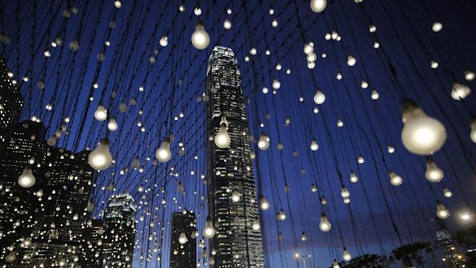 "In this photo taken Thursday, Sept. 11, 2014, an artwork titled ""Scattered Light,"" created by American artist Jim Campbell, is lit at an exhibition in Hong Kong's Central district. The installation that has a structure with 2,000 light bulbs was presented by the Hong Kong Arts Development Council. (AP Photo/Vincent Yu)"