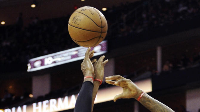 Miami Heat's LeBron James (6) shoots while guarded by Houston Rockets' Marcus Morris (2) in the first half of an NBA basketball game, Monday, Nov. 12, 2012, in Houston. (AP Photo/Pat Sullivan)