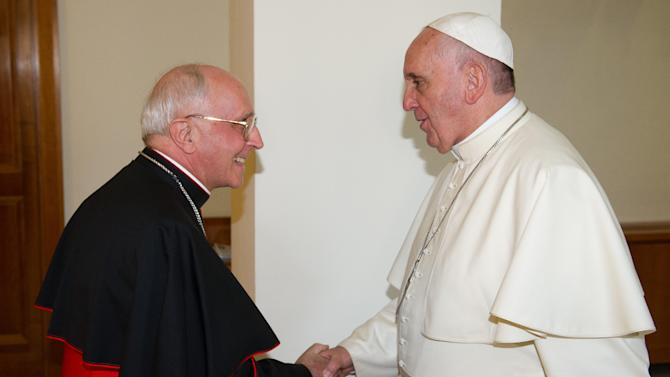 In this photo taken on Sunday, Aug. 10, 2014 provided by the Vatican paper L'Osservatore Romano, Pope Francis shakes hands with Cardinal Fernando Filoni at the Vatican. Pope Francis is sending Cardinal Filoni as his personal envoy to Iraq to show solidarity with Christians who have been forced from their homes by Islamic militants. (AP Photo/L'Osservatore Romano)