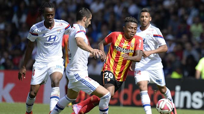 Lens' midfielder Lalaina Nomenjanahary (2nd R) vies for the ball with Lyon's midfielder Maxime Gonalons (2nd L) and defender Bakary Kone (L) on August 24, 2014