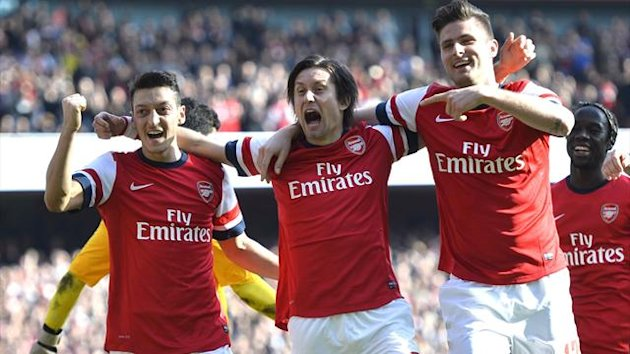 Mesut Ozil, Tomas Rosicky and Olivier Giroud celebrate a goal against Everton (Reuters)