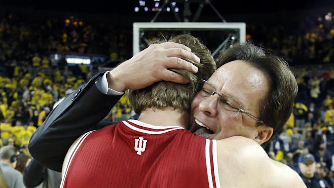 Indiana coach Tom Crean, right, hugs guard Jordan Hulls (1) after a come-from-behind, 72-71 win over Michigan in an NCAA college basketball game Sunday, March 10, 2013, in Ann Arbor, Mich. (AP Photo/Duane Burleson)