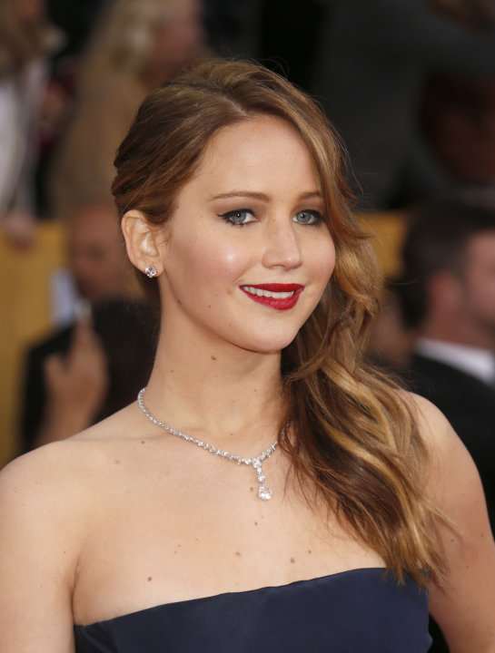 Jennifer Lawrence arrives at the 19th Annual Screen Actors Guild Awards at the Shrine Auditorium in Los Angeles on Sunday Jan. 27, 2013. (Photo by Todd Williamson/Invision for The Hollywood Reporter/A