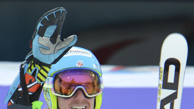 United States's TedLigety celebrates winning the gold medal after the second run of the men's giant slalom  at the Alpine skiing world championships in Schladming, Austria, Friday, Feb. 15, 2013. (AP Photo/Kerstin Joensson)