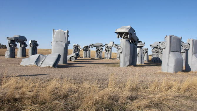 File - This file photo from March 24, 2004, shows Carhenge, western Nebraska's automotive replica of England's famed Stonehenge, near Alliance, Neb. The Alliance City Manager and the Alliance Visitors Bureau are considering taking over the site after the Friends of Carhenge offered to give the attraction and 10 surrounding acres to the city. (AP Photo/Nati Harnik)