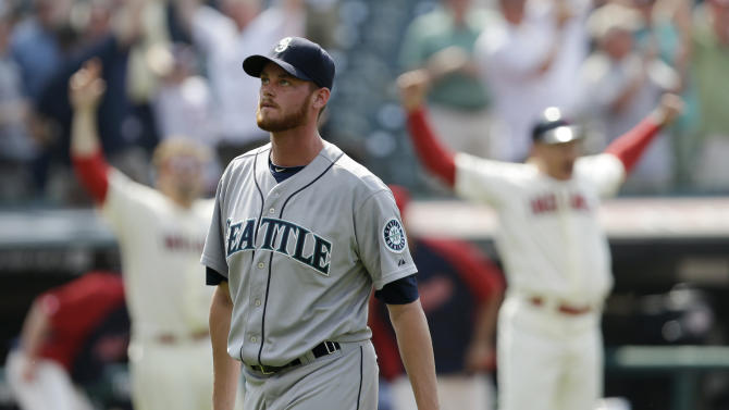 Seattle Mariners relief pitcher Charlie Furbush walks off the field after giving up a three-run home run to Cleveland Indians' Yan Gomes in the tenth inning of a baseball game, Monday, May 20, 2013, in Cleveland. The Indians won 10-8 in 10 innings. (AP Photo/Tony Dejak)