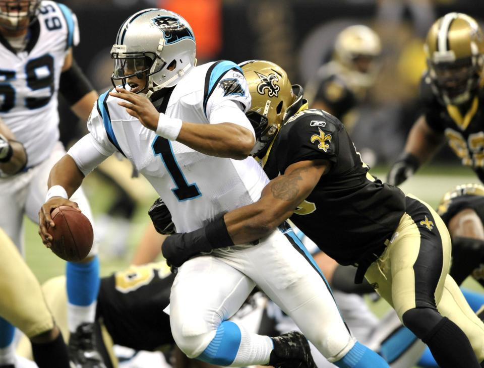 Carolina Panthers quarterback Cam Newton (1) is sacked by New Orleans Saints outside linebacker Martez Wilson (95) during the third quarter of an NFL football game in New Orleans, Sunday, Jan. 1, 2012. (AP Photo/Bill Feig)