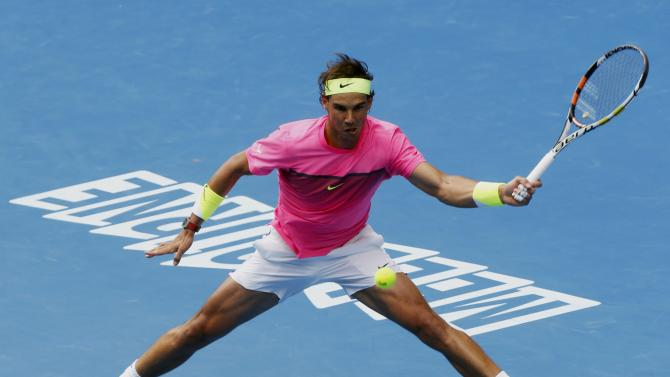 Nadal of Spain stretches to hit a return to Berdych of the Czech Republic during their men's singles quarter-final match at the Australian Open 2015 tennis tournament in Melbourne