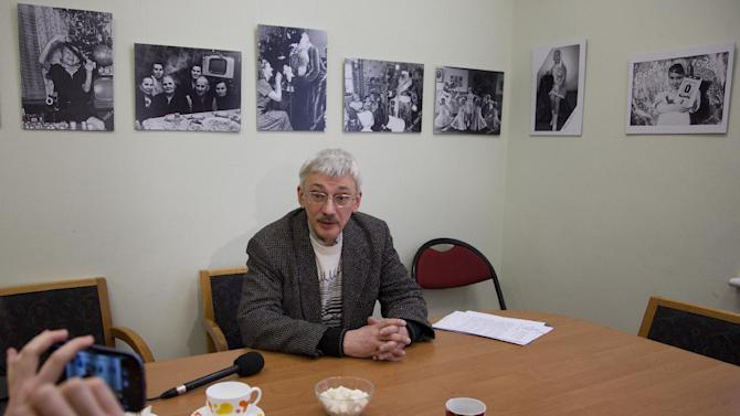 Oleg Orlov, member of Russian human rights group Memorial, talks to the media in his office in Moscow, Russia, on Thursday, March 21, 2013, as prosecutors search for documents pertaining to all of its activities. The media arrived at the offices after social media alerted them to the search, but were not able to view the search happening.  Russian prosecutors are searching the offices of Memorial, one of the country's oldest and most respected rights nongovernmental organizations NGOs, which used to be funded from the U.S. Agency for International Development USAID, but funding dried up after Russia kicked USAID out of the country last year. (AP Photo/Ivan Sekretarev)