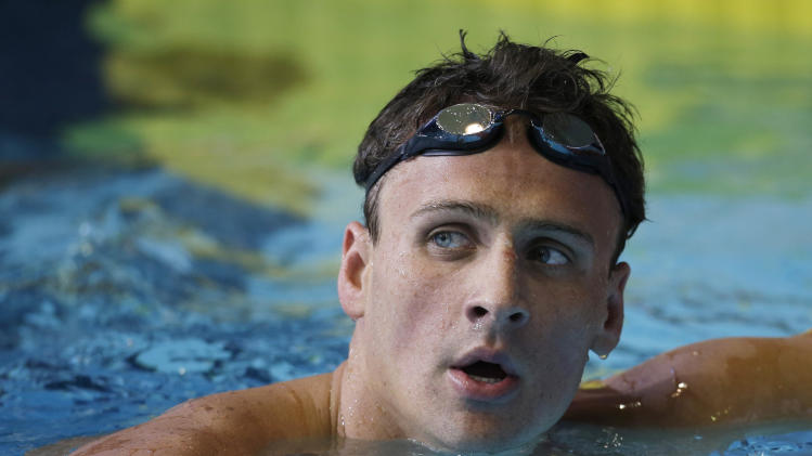 Ryan Lochte looks up at the scoreboard after winning the men's 200-meter backstroke during the U.S. National Championships swimming meet Wednesday, June 26, 2013, in Indianapolis. (AP Photo/Darron Cummings)