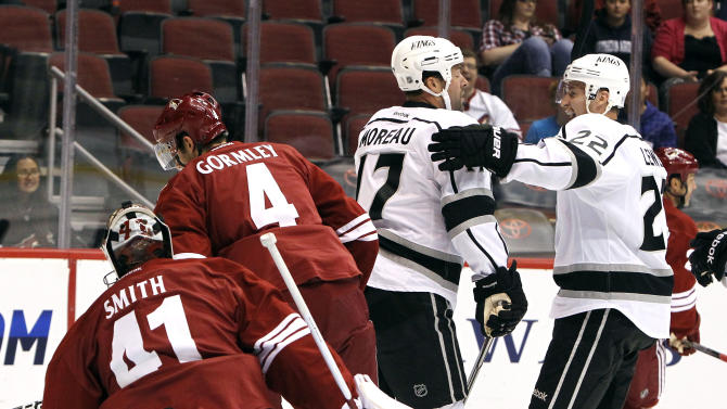 Los Angeles Kings' Ethan Moreau (17) celebrates his goal against the Phoenix Coyotes with teammate Trevor Lewis (22) as Coyotes' Mike Smith (41) and Brandon Gormley (4) skate away during the first period in a preseason NHL hockey game on Wednesday, Sept. 21, 2011, in Glendale, Ariz. (AP Photo/Ross D. Franklin)