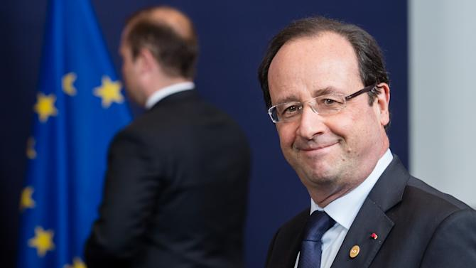 French President Francois Hollande arrives for a group photo during an EU summit in Brussels on Wednesday, May 22, 2013. Leaders from the 27 European Union countries gather in Brussels for one of their regular European Council sessions. On the agenda is the increasingly controversial subject of tax evasion. Countries such as Austria and Luxembourg which have lucrative, and somewhat opaque, banking systems have begun to fight back against efforts to improve the transparency of the EU's financial system.(AP Photo/Geert Vanden Wijngaert)