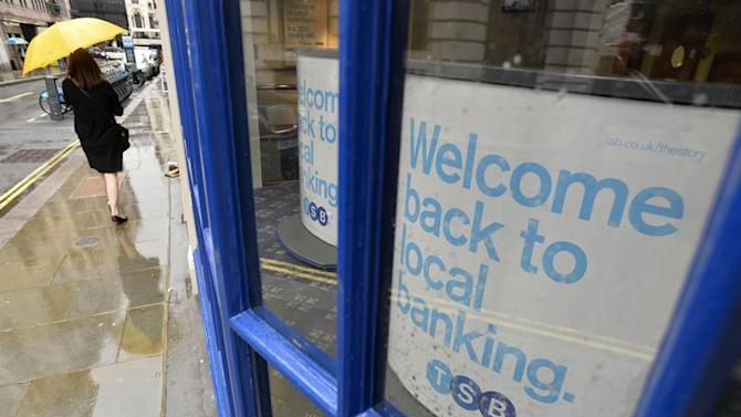 A pedestrian walks past a branch of the TSB bank in central London