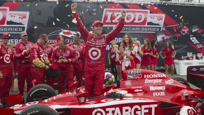 Dario Franchitti, of Scotland, celebrates after winning the IndyCar Series' Honda Toronto Indy auto race in Toronto on Sunday, July 10,  2011. (AP Photo/The Canadian Press, Chris Young)
