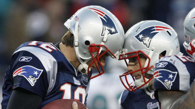 New England Patriots quarterback Tom Brady (12) celebrates his touchdown with teammate wide receiver Wes Welker (83) during the fourth quarter against the Miami Dolphins in an NFL football game at Gillette Stadium in Foxborough, Mass. Saturday, Dec. 24, 2011. (AP Photo/Charles Krupa)