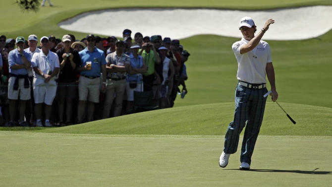 Rory McIlroy, of Northern Ireland, reacts to a missed putt on the third green during the third round of the Masters golf tournament Saturday, April 7, 2012, in Augusta, Ga. (AP Photo/Matt Slocum)