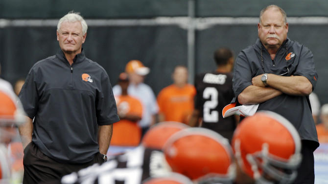 FILE - In this Aug. 21, 2012, file photo, Cleveland Browns president Mike Holmgren, right, watches practice with new owner Jimmy Haslam during training camp at the NFL football team's practice facility in Berea, Ohio. The sale of the Cleveland Browns to Haslam III was unanimously approved by NFL owners Tuesday, and Holmgren will be leaving the Browns at the end of the season. (AP Photo/Mark Duncan, File)