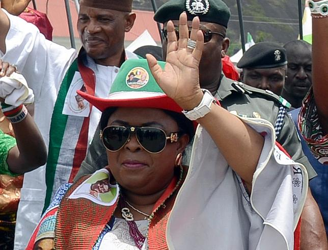 Patience Jonathan (C) waves as she campaigns for her husband, Goodluck, during a rally ahead of presidential electiona in Akure, Nigeria, on March 24, 2015 (AFP Photo/Pius Utomi Ekpei)
