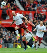 Aston Villa's Irish midfelder Stephen Ireland (L) and Manchester United's Brazilian defender Rafael Da Silva (C) compete during the English Premier League football match between Manchester United and Aston Villa at Old Trafford in Manchester. United won 4-0