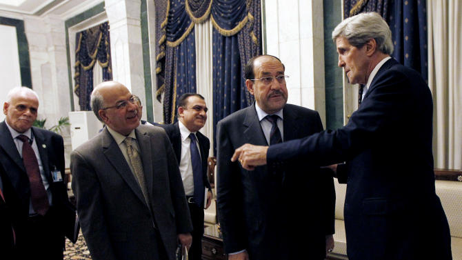 U.S. Secretary of State John Kerry, right meets with Iraq's Prime Minister Nouri al-Maliki, second right, in Baghdad, Iraq, Sunday, March 24, 2013. U.S. Secretary of State John Kerry made an unannounced visit to Iraq on Sunday and will urge Prime Minister Nouri al-Maliki to make sure Iranian flights over Iraq do not carry arms and fighters to Syria, a U.S. official said. (AP Photo/Jason Reed, Pool)