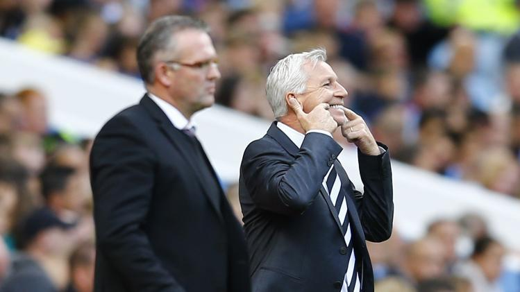 Newcastle United manager Pardew reacts as Aston manager Lambert watches his team during their English Premier League soccer match at Villa Park in Birmingham