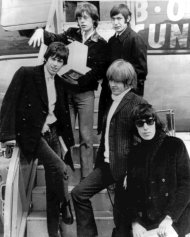 FILE - In this April 22, 1965 file photo, British rock and roll group, The Rolling Stones, arrive at Montreal Airport. They are Mick Jagger, top left, Charlie Watts, top right, Keith Richards, middle left, Brian Jones, middle right, and Bill Wyman. The Cleveland-based The Rock and Roll Hall of Fame Museum will open Rolling Stones: 50 Years of Satisfaction, an exclusive exhibit celebrating the archetypal rock band, on May 24, 2013. (AP Photo, File)