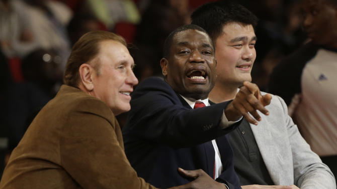 Former Houston Rockets coach Rudy Tomjanovich, left, and players Dikembe Mutombo and Yao Ming, right, confer as they judge the slam dunk contest during NBA All-Star Saturday Night basketball in Houston on Saturday, Feb. 16, 2013. (AP Photo/Pat Sullivan)