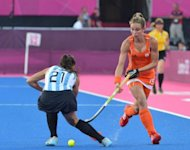 Netherlands Ellen Hoog (R) is chalenged by Argentina's Mariela Scarone during the women's field hockey gold medal match at The Riverbank Arena in London. Netherlands won 2-0
