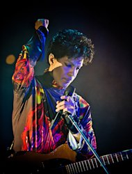 This Fall 2012 photo provided by Rogers and Cowan shows musician Prince performing at a concert in Chicago. Prince turns off the lights at South by Southwest on Saturday, March 16, 2013, with an unexpected and intimate showcase that ranks among the biggest surprises in years at the star-studded music festival and conference. (AP Photo/Rogers and Cowan)