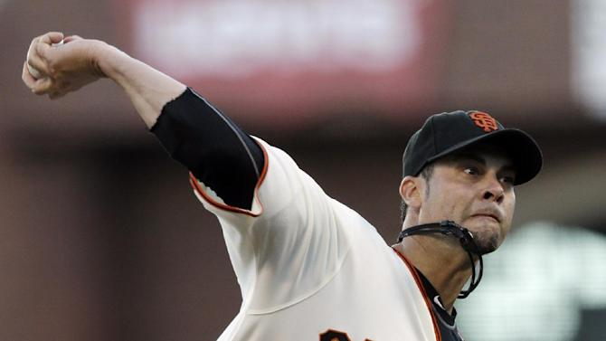 San Francisco Giants starting pitcher Ryan Vogelsong throws during the first inning of Game 2 of baseball's National League championship series against the St. Louis Cardinals Monday, Oct. 15, 2012, in San Francisco. (AP Photo/Ben Margot)