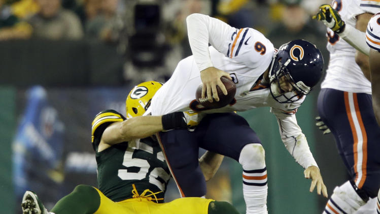 Green Bay Packers' Clay Matthews (52) sacks Chicago Bears' Jay Cutler (6) during the second half of an NFL football game Thursday, Sept. 13, 2012, in Green Bay, Wis. (AP Photo/Jeffrey Phelps)