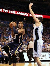 Danny Granger (L) of the Indiana Pacers shoots past Orlando Magic&#39;s Hedo Turkoglu during game three of the NBA Eastern Conference first-round playoff series on May 2. The Pacers won 97-74