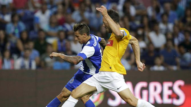 Porto's Tello fights for the ball with Estoril's Tavares during their Portuguese Premier League soccer match at Dragao stadium in Porto