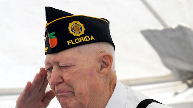 "Joe McKinney, the chaplain of American Legion Post 88 who everyone calls ""Father Joe,"" becomes emotional after giving the keynote address during a ceremony remembering the 71st anniversary of the attack on Pearl Harbor on aboard the USS De Wert on Friday, Dec. 7, 2012, at the Naval Station Mayport in Jacksonville, Fla.  (AP Photo/Florida Times-Union, Bruce Lipsky)"