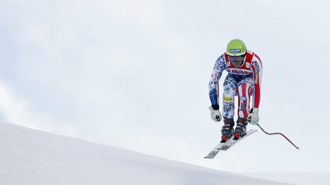 Bode Miller of USA clears the Hundschopf during the Super Combined downhill race at the FIS Ski World Cup at the Lauberhorn in Wengen, Switzerland, Friday, Jan. 14, 2011. (AP Photo/Keystone, Peter Klaunzer)