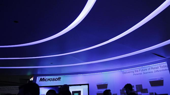 "FILE- In this Tuesday, Jan. 17, 2012, file photo, attendees at the National Retail Federation visit a Microsoft display in New York. Microsoft Corp. said Monday, June 18, 2012, it will make a ""major"" announcement after the market closes on Monday. Speculation has ranged from an unveiling of a new tablet computer that uses low-power chips to a new system that will use an upcoming version of Windows to (AP Photo/Mark Lennihan, File)"