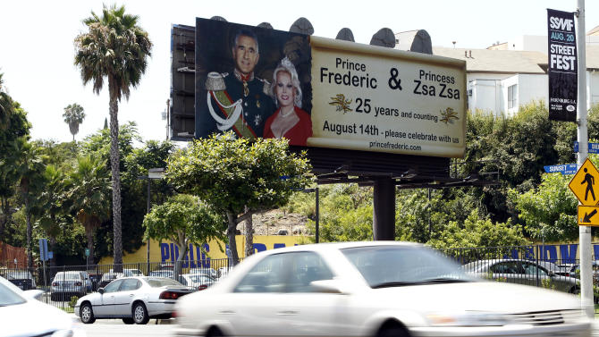 A billboard showing an original wedding photo of Zsa Zsa Gabor and Prince Frederic von Anhalt is seen on Sunset Blvd. in West Hollywood, Calif., Thursday, July 28, 2011. Gabor and von Anhalt will celebrate their 25th Wedding Anniversary on Aug. 14. (AP Photo/Matt Sayles)