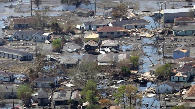 FILE - This Sept. 11, 2005 file photo shows a neighborhood destroyed by Hurricane Katrina in New Orleans. Inspectors taking the first-ever inventory of flood control systems overseen by the federal government have found hundreds of structures at risk of failing and endangering people and property in 35 states. Levees deemed in unacceptable condition span the breadth of America. They are in every region, in cities and towns big and small. (AP Photo/David J. Phillip, File)