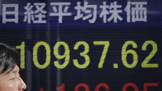 Asia stocks mixed, Nikkei falls as yen slide halts