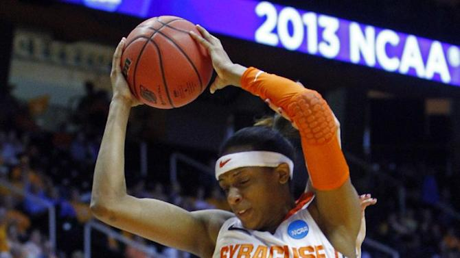 Syracuse guard Brittney Sykes (20) falls over Creighton guard Sammy Jensen (5) as she rebounds the ball in the first half of a first-round game in the women's NCAA college basketball tournament on Saturday, March 23, 2013, in Knoxville, Tenn. (AP Photo/Wade Payne)