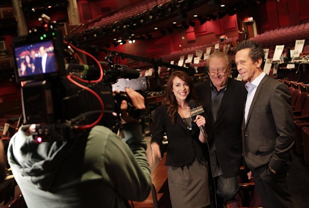 In this Thursday Feb. 23, 2012 photo, 84th Annual Academy Awards producers, from right, Brian Grazer and Don Mischer, chat with Shira Lazar of Oscar.com at the Kodak Theatre in Los Angeles. The Academy Awards will be held on Sunday.(AP Photo/Chris Carlson)