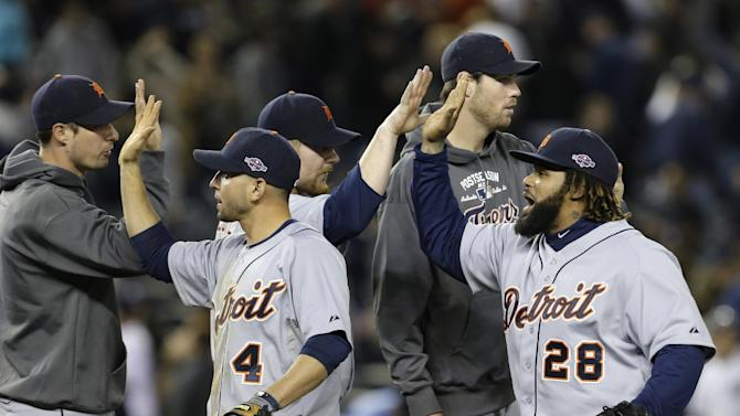 Detroit Tigers' Omar Infante (4) and Prince Fielder (28) celebrate with teammates after Detroit defeated the New York Yankees, 3-0,  in Game 2 of the American League championship series Sunday, Oct. 14, 2012, in New York. (AP Photo/Paul Sancya )
