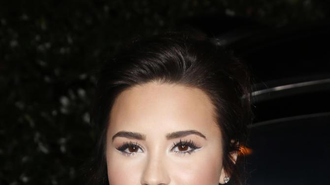 Demi Lovato attends the Topshop Topman LA Opening Party At Cecconi's in Los Angeles, on Wednesday, Feb. 13, 2013 in Los Angeles. (Photo by Todd Williamson/Invision for/AP)