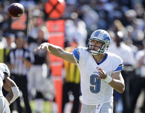 Stafford injures hand, Lions lose 31-20 to Raiders
