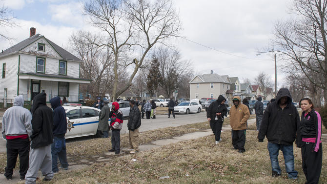 Crowds gather along Holton Avenue in Fort Wayne, Ind. after an eight hour stand-off ended in the rescue of a 3-year-old boy being held hostage and the death of suspect Kenneth Knight Wednesday afternoon, March 20, 2013. Knight pulled a woman off a city bus, fatally shot her and then took the boy hostage before a sniper killed him during a police standoff. (AP Photo/The Journal-Gazette, Swikar Patel)  NEWS-SENTINEL OUT; MANDATORY CREDIT; NO SALES; MAGS OUT