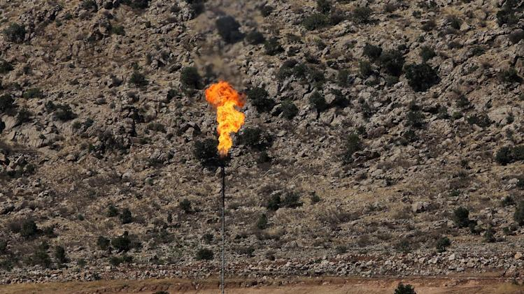 Picture taken on August 10, 2014 shows an oil field in Sheikhan, northeast of the city of Mosul in northern Iraq, an area where Kurdish peshmerga forces were fighting Islamic State militants