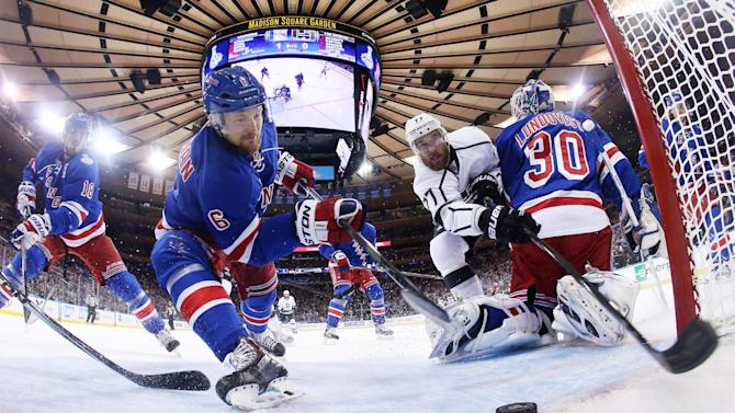 AP10ThingsToSee- New York Rangers defenseman Anton Stralman (6) reaches to save the puck from crossing the goal line as Los Angeles Kings center Jeff Carter (77) tries to score from behind New York Rangers goalie Henrik Lundqvist (30) in the first period during Game 4 of the NHL hockey Stanley Cup finals, Wednesday, June 11, 2014, in New York