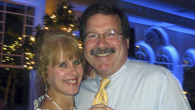 This undated photo provided by Mark Sherlach shows him with his wife, school psychologist Mary Sherlach, who was killed Friday, Dec. 14, 2012, when a gunman opened fire at Sandy Hook Elementary School, in Newtown, Conn.  Mary Sherlach will be one of six educators from the school honored posthumously with the 2012 Presidential Citizens Medal, presented at a White House ceremony on Feb. 15, 2013.  (AP Photo/Courtesy of Mark Sherlach)